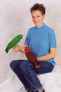 owner with eclectus parrots